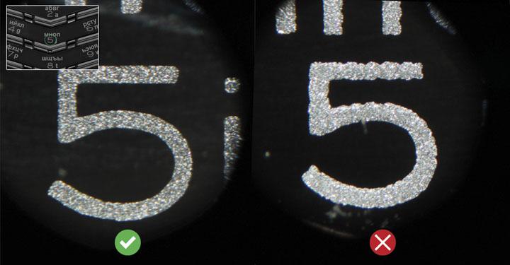 Проверка шрифта обозначений на клавишах под микроскопом