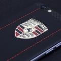 iPhone с логотипом Porsche
